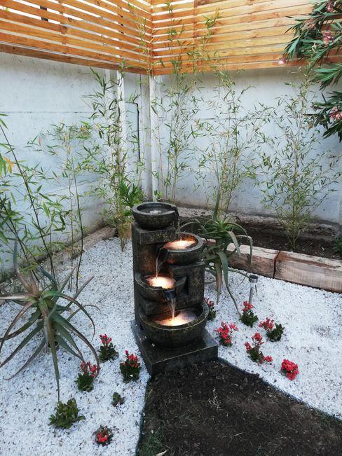 DESPUÉS - FUENTE - ILUMINACIÓN EXTERIOR HZ ARQUITECTOS SANTIAGO DISEÑO COCINAS JARDINES PAISAJISMO REMODELACIONES OBRA Jardines minimalistas