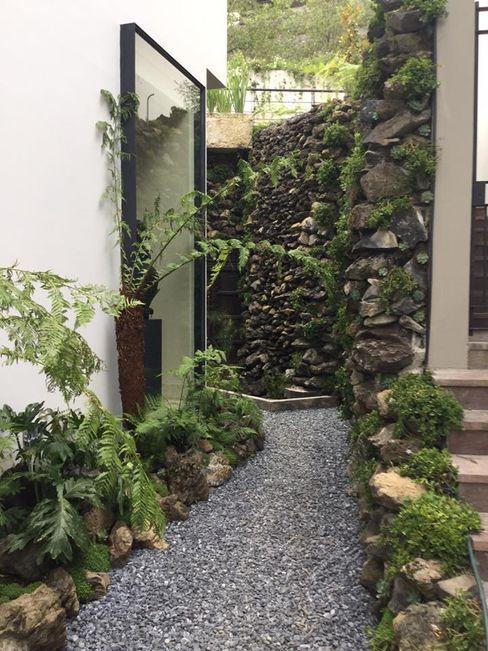Vista del acceso posterior Huatan Jardines tropicales