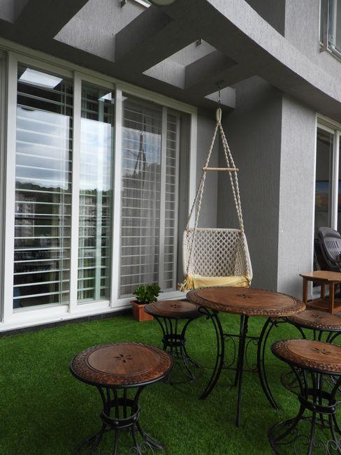Home down the Memory lane. Ashwini Ghayal Designs Asian style balcony, veranda & terrace