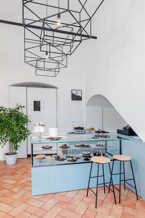 Area vendita manuarino architettura design comunicazione Negozi & Locali commerciali in stile minimalista Legno Turchese
