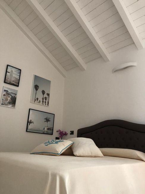 Camera da letto ROMAZZINO C.S. SERVICE SRL Camera da letto moderna
