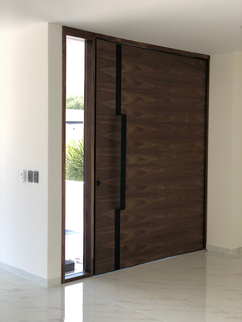 Casa L Cstudio Arquitectura & Diseño Puertas modernas Madera Acabado en madera