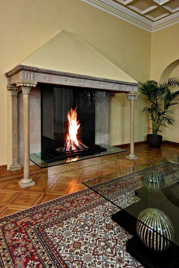 Modern glass fireplace inside an original Italian style fireplace Bloch Design Living roomFireplaces & accessories