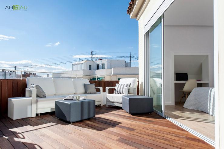 ATICO EN JOAQUIN COSTA amBau Gestion y Proyectos Balcones y terrazas de estilo ecléctico