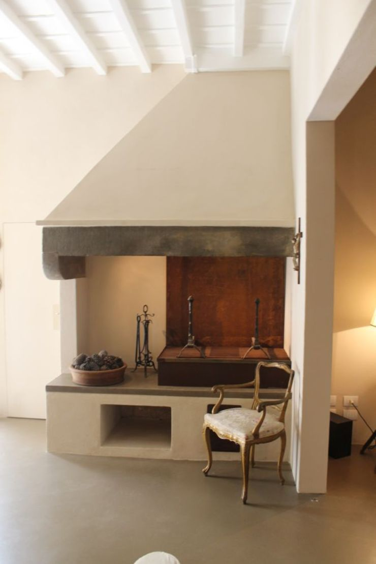 Abitazione in San Frediano, Firenze Studio Tecnico Progettisti Associati Ing. Marani Marco & Arch. Dei Claudia Soggiorno eclettico