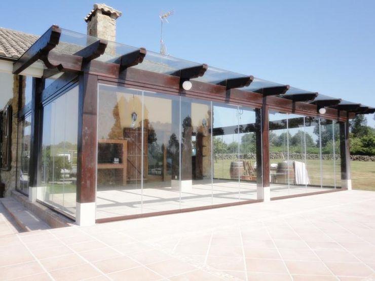 Estructura de madera y cerramiento con cortina de cristal homify HogarAccesorios y decoración