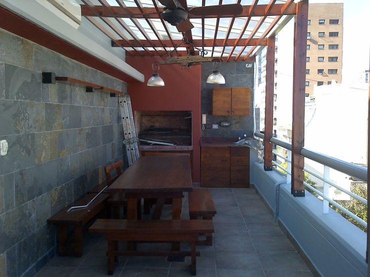 realización de quincho en terraza Remodelaciones SF Balcones y terrazas rústicos
