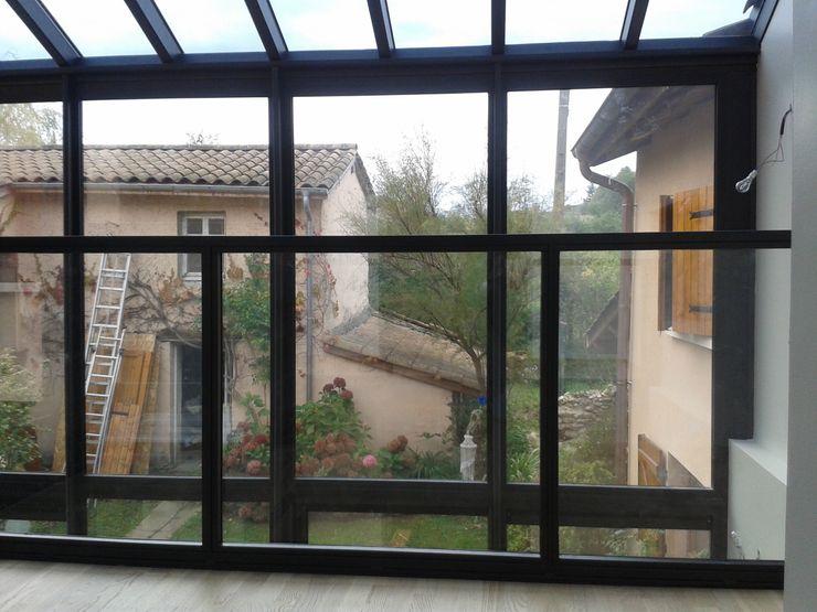 Maison ossature métallique Carole Guyon architecte Balcon, Veranda & Terrasse industriels