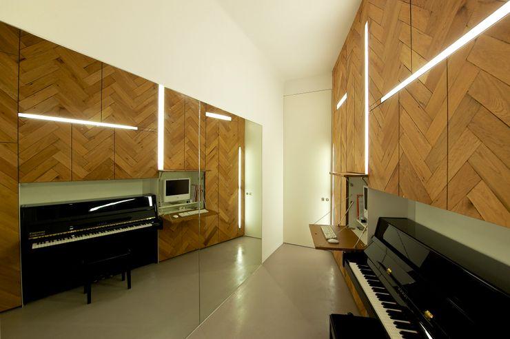 3rdskin architecture gmbh Salas multimedia de estilo ecléctico