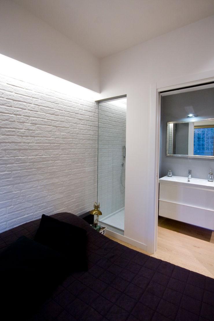 Loft CF_Manuela Tognoli Interiors Manuela Tognoli Architettura Camera da letto in stile industriale