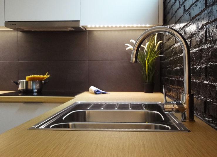 Encimera madera Formica davidMUSER building & design Cocinas de estilo moderno