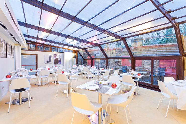 veranda arcHITects srl Negozi & Locali commerciali in stile industrial
