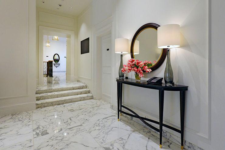 homify Corridor, hallway & stairsLighting