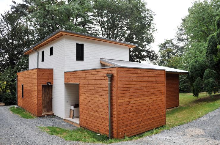 Empreinte Constructions bois 모던스타일 주택