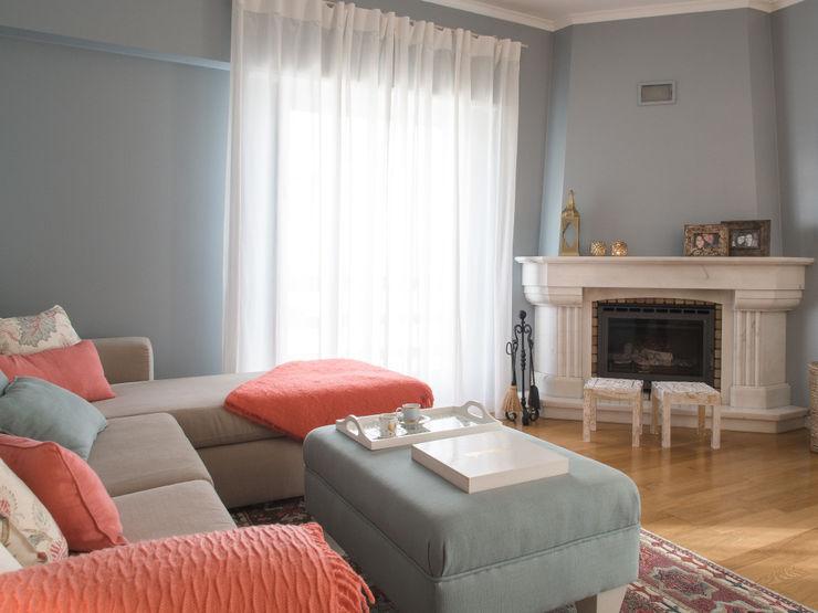 MUDA Home Design Salones de estilo moderno