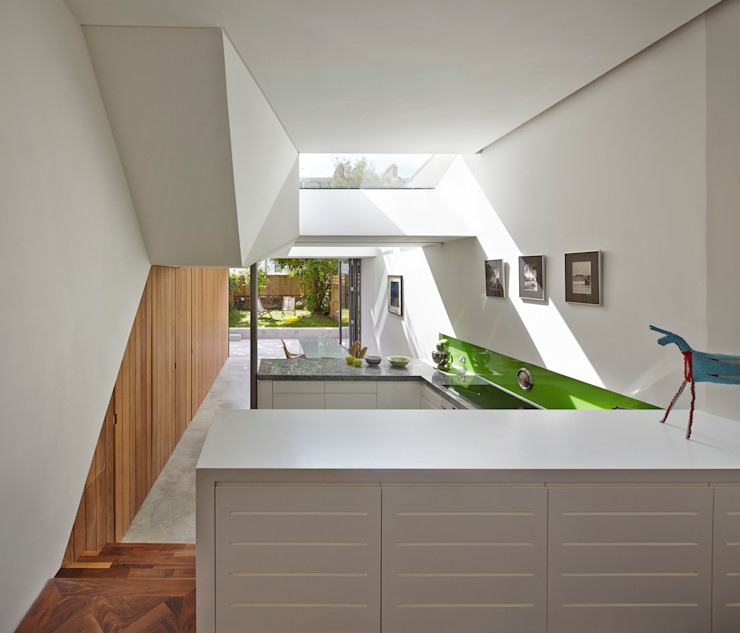 View towards kitchen and garden Neil Dusheiko Architects Modern kitchen