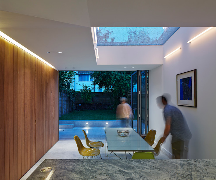 View towards dining area at night Neil Dusheiko Architects Modern dining room