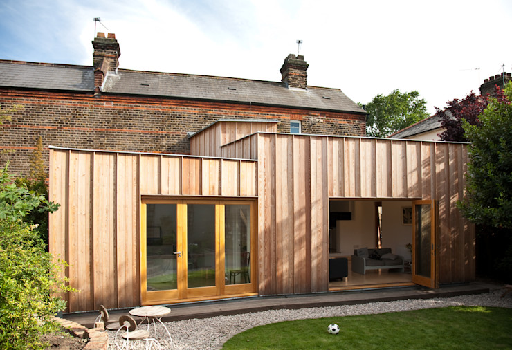 Rear elevation showing timber extension Neil Dusheiko Architects Modern houses