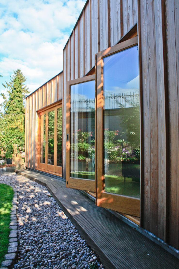 Bi-folding doors to rear elevation Neil Dusheiko Architects Modern houses