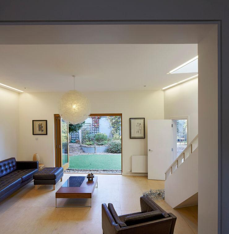 Living area opening onto garden Neil Dusheiko Architects Modern living room