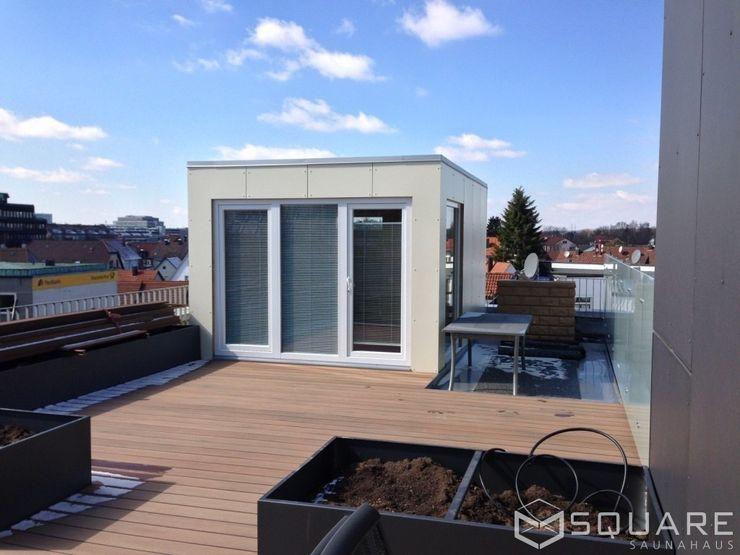 Saunahaus SQUARE XL auf der Dachterrasse - Fassade: beige HPL-Platten SQUARE Saunahaus Moderner Spa