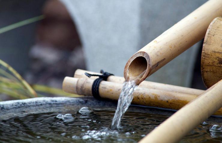 Tetsu bachi granite bowl water feature Lush Garden Design JardínAccesorios y decoración