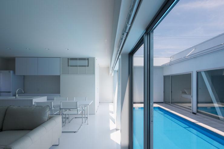 l a n i *studio LOOP 建築設計事務所 Piletas modernas: Ideas, imágenes y decoración