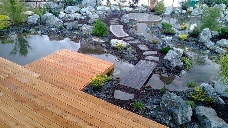 Teichanlage mit Diabasfindlingen Neues Gartendesign by Wentzel Mediterraner Garten