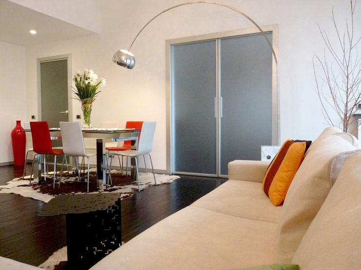 Zona Living Studio Zay Architecture & Design Soggiorno moderno Legno Beige