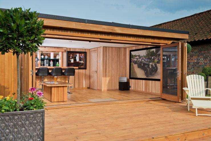 Bespoke garden cinema room with a bar Crown Pavilions Garasi Modern