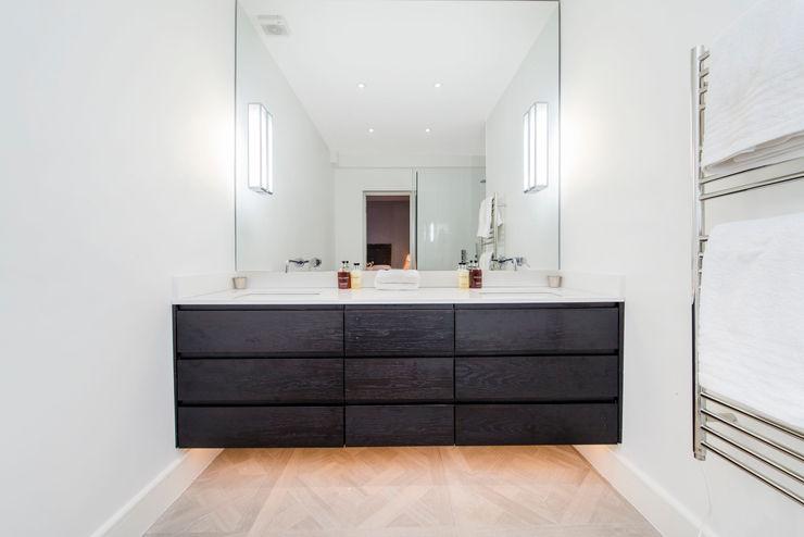 Parquet flooring and underlit counters Balance Property Ltd Modern style bathrooms
