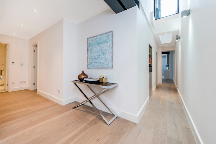 Bright corridor with skylights Balance Property Ltd Modern corridor, hallway & stairs