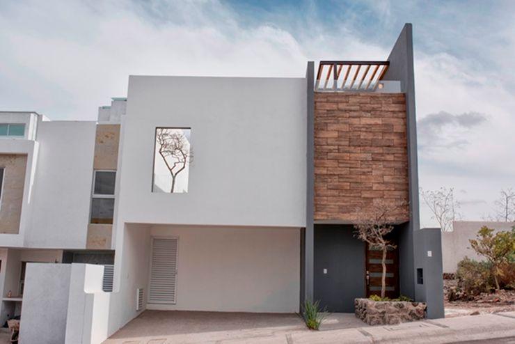 Fachada JF ARQUITECTOS Casas de estilo minimalista