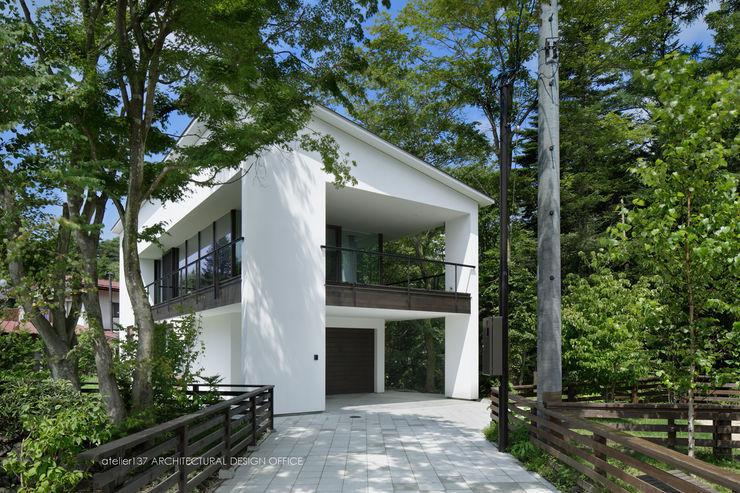 atelier137 ARCHITECTURAL DESIGN OFFICE Nowoczesne domy Czarny