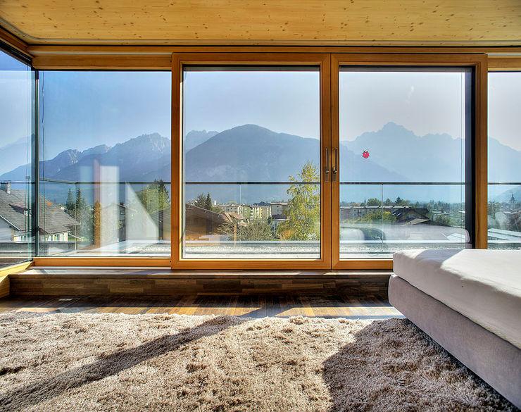 pedit&partner architekten Modern style bedroom