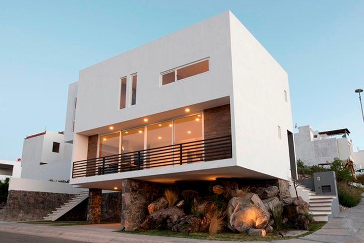Fachada JF ARQUITECTOS Casas minimalistas