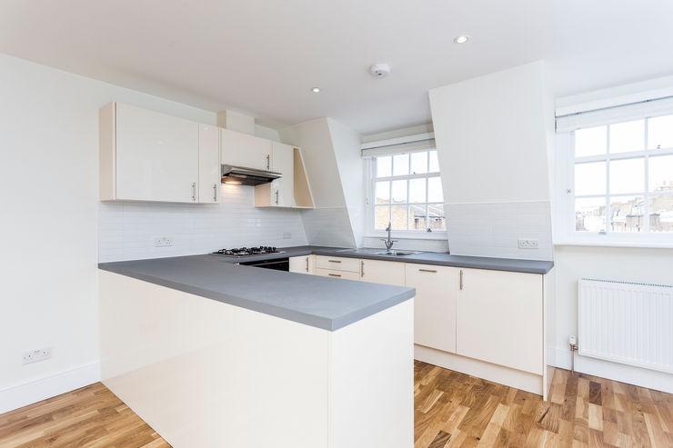 Flat Conversion in Islington GK Architects Ltd KitchenCabinets & shelves