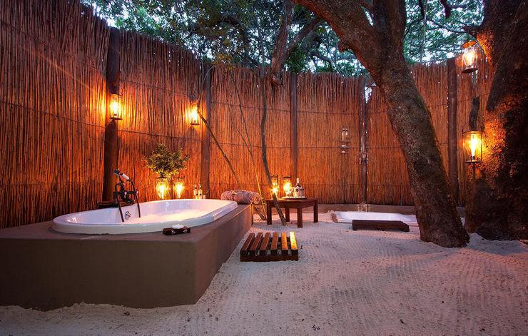 Design by Torsten Müller Baños de estilo tropical