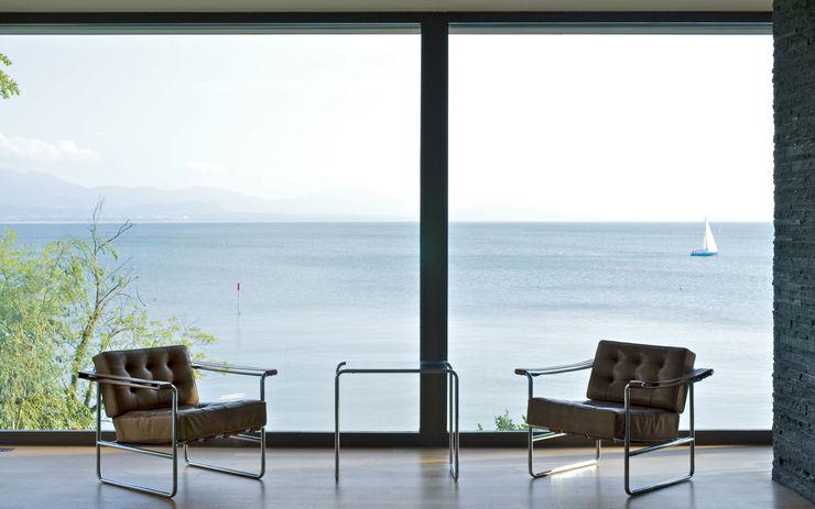 Villa Hubbell Swartz MACH Architektur GmbH WohnzimmerHocker und Stühle