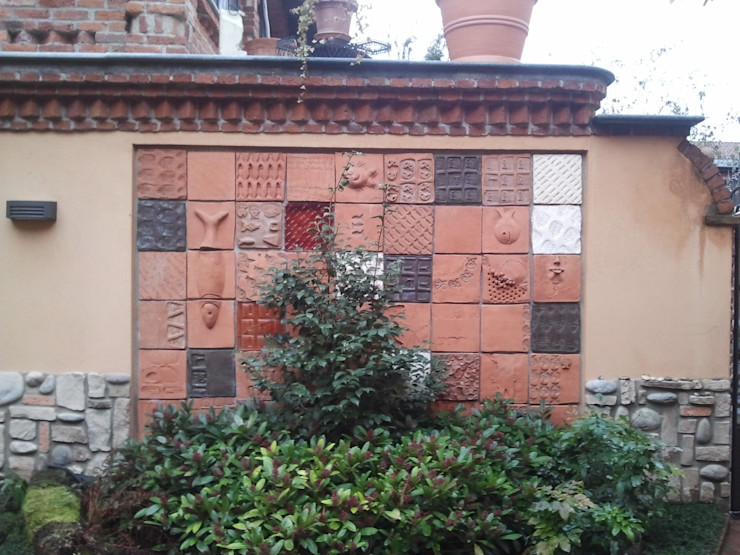 Parete multimaterica Nino Ventura & C. Giardino in stile mediterraneo