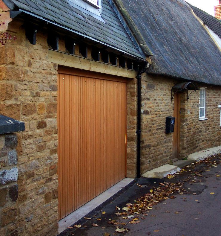 Vertical boarding garage door The Garage Door Centre Limited Гаражі та навіси