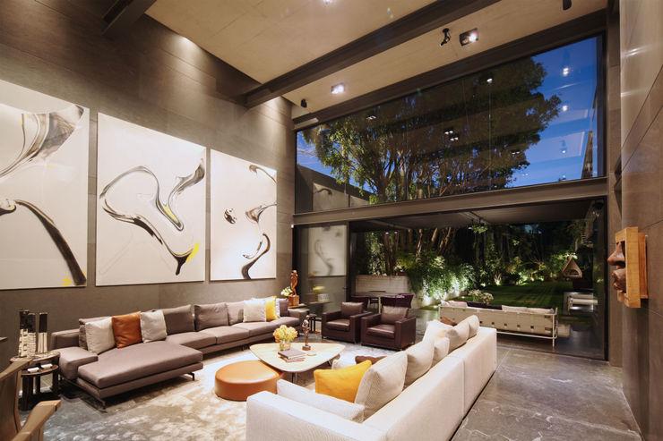 Casa Basaltica grupoarquitectura Salones de estilo minimalista