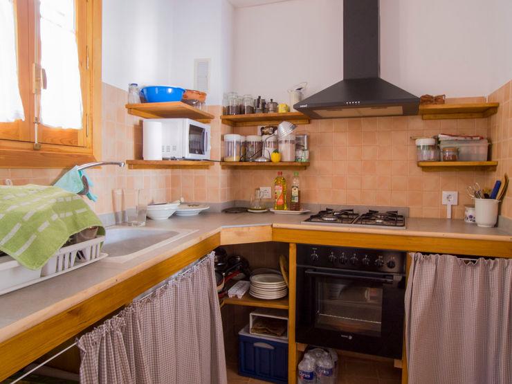 FGMarquitecto Rustic style kitchen