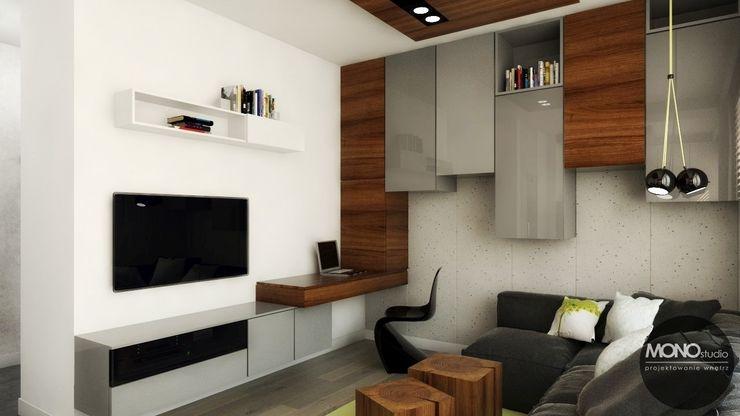 Urocze mieszkanie zaaranżowane w nowoczesnym stylu MONOstudio Nowoczesny salon