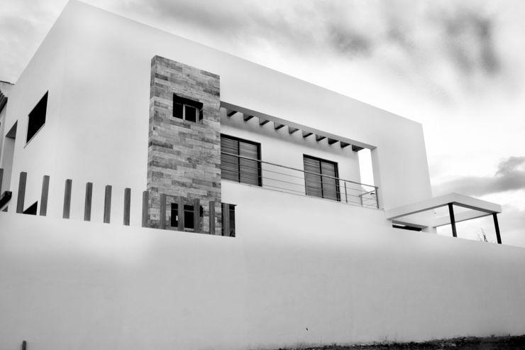 Vista exterior general Mohedano Estudio de Arquitectura S.L.P. Casas adosadas Blanco