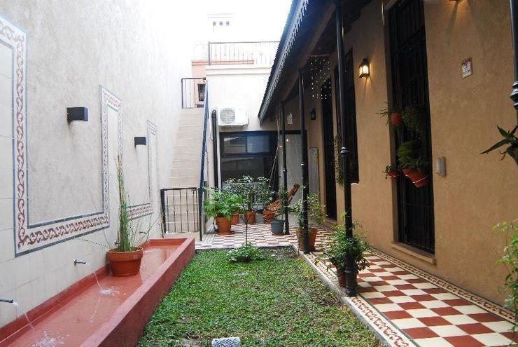 patio después Parrado Arquitectura Jardines eclécticos