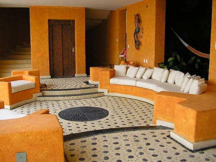 Terraza abierta ARQUELIGE Balcones y terrazas tropicales