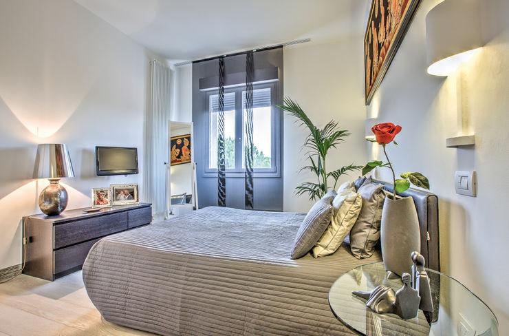 Camera da letto GHINELLI ARCHITETTURA Camera da letto eclettica