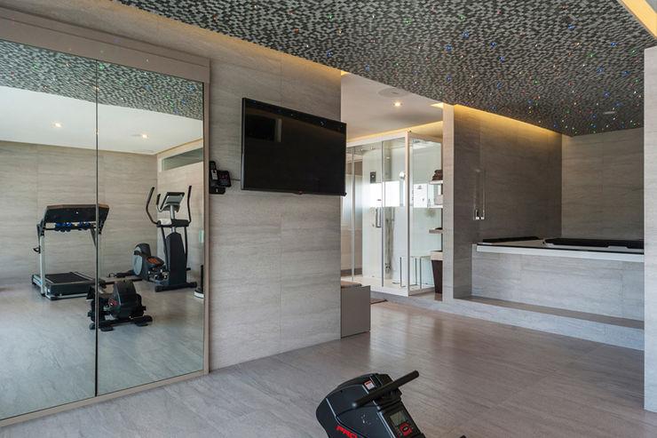 DEPARTAMENTO EN BOSQUE REAL HO arquitectura de interiores Gimnasios domésticos modernos