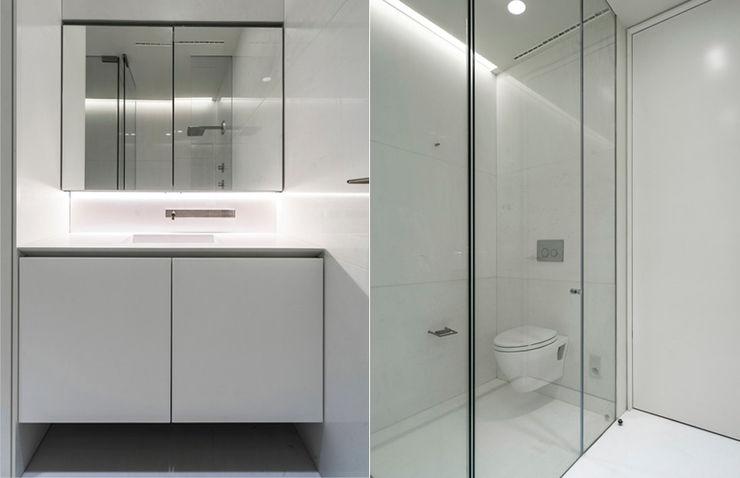 ST. REGIS 2301 TENTER Arquitectura y Diseño Baños modernos Mármol Blanco